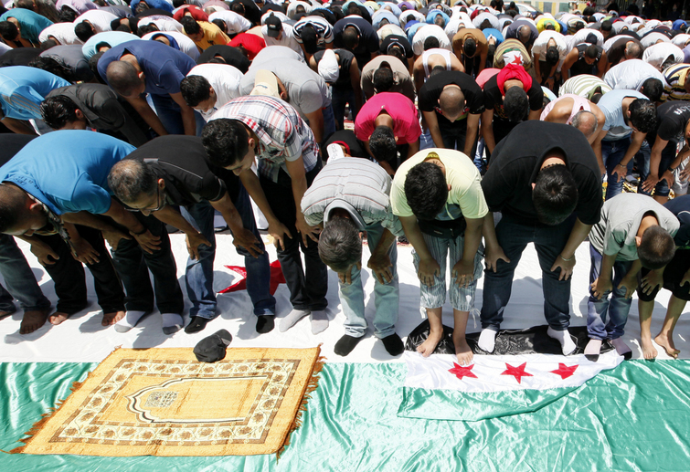 Lebanese and Syrian Sunni Muslims perform Friday prayers in Beirut