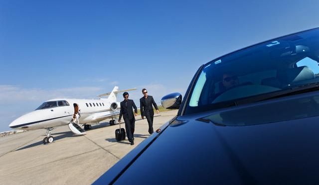 Businessmen Arriving at Airport --- Image by © James Lauritz/Corbis